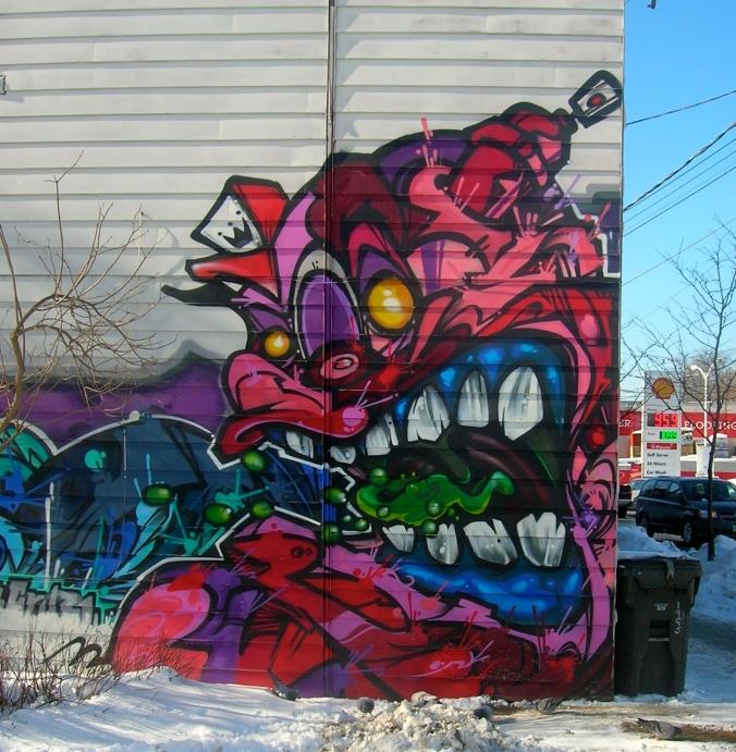 detail on shop wall, west end Columbus Parkette